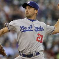 Photo -   Los Angeles Dodgers starting pitcher Ted Lilly (29) pitches to Colorado Rockies' Eric Young Jr. during the first inning of a baseball game Tuesday, May 1, 2012 in Denver. (AP Photo/Barry Gutierrez)