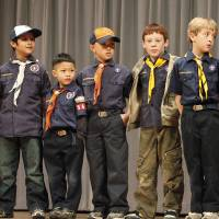 """Photo - Cub Scouts from Pack 543 appear on stage at the Boy Scouts of America annual fundraising """"Character Counts"""" breakfast this month. Photo by David McDaniel, The Oklahoman"""