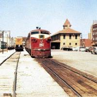 Photo -  The Rock Island Plow Building can be seen to the right of the now vanished MKT Train Depot in this vintage mid-20th century photo (courtesy of the Oklahoma Railway Museum)