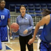 Photo - Duke coach Joanne P. McCallie, center, watches during practice for the NCAA women's college basketball tournament in Durham, N.C., Friday, March 21, 2014.  Duke faces Winthrop in the first round on Saturday. (AP Photo/Ted Richardson)