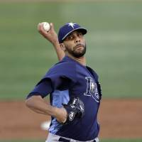 Photo - Tampa Bay Rays starting pitcher David Price throws during the first inning of an exhibition spring training baseball game against the Baltimore Orioles, Thursday, March 28, 2013, in Sarasota, Fla. (AP Photo/Carlos Osorio)