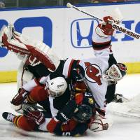 Photo -   Florida Panthers' Marcel Goc (57) and New Jersey Devils' Andy Greene (6) collide with Devils goalie Martin Brodeur (30) during the first period of Game 2 of an NHL hockey Stanley Cup first-round playoff series in Sunrise, Fla., Sunday, April 15, 2012. (AP Photo/J Pat Carter)
