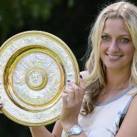 Photo - Czech tennis player Petra Kvitova holds the trophy of the All England Lawn Tennis Championships in Wimbledon at the press conference in Prague, Monday, July 7, 2014. She won the women's singles final against Eugenie Bouchard of Canada.  (AP Photo,CTK/Roman Vondrous)    SLOVAKIA OUT
