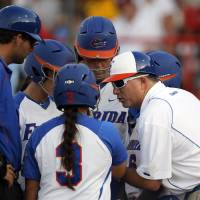 Photo - Florida coach Tim Walton, right, is one of the four male coaches remaining in the WCWS.  Photo by Sarah Phipps, The Oklahoman