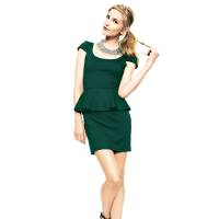 Photo - After color authority Pantone named emerald the official color of 2013, the green tone began popping up on runways and in stores everywhere. Here, Amanda Uprichard ponte peplum dress, $174, Cusp.com by Neiman Marcus. (Courtesy Cusp.com via Los Angeles Times/MCT)