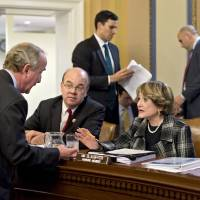 Photo - Rep. Rodney Frelinghuysen, R-N.J., left, confers with Rep. Louise Slaughter, D-N.Y., Rep. Jim McGovern, D-Mass., center, as the House Rules Committee sorts through dozens of amendments on an aid package to assist victims of Superstorm Sandy that devastated parts of the Northeast coast in October, at the Capitol in Washington, Monday, Jan. 14, 2013. The House is expected to vote on the bill Tuesday. (AP Photo/J. Scott Applewhite)