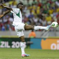 Photo - FILE - In this June 23, 2013, file photo, Nigeria's Brown Ideye kicks the ball during the soccer Confederations Cup group B match between Nigeria and Spain at the Castelao stadium in Fortaleza, Brazil. (AP Photo/Natacha Pisarenko,File)