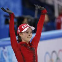 Photo - Julia Lipnitskaia of Russia waves to spectators after competing in the women's team free skate figure skating competition at the Iceberg Skating Palace during the 2014 Winter Olympics, Sunday, Feb. 9, 2014, in Sochi, Russia. (AP Photo/David J. Phillip)