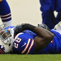 Photo -   Buffalo Bills running back C.J. Spiller lies on the field after injuring his shoulder on a first-quarter run against the Cleveland Browns in an NFL football game on Sunday, Sept. 23, 2012, in Cleveland. (AP Photo/Tony Dejak)