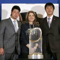 Photo - U.S. Ambassador to Japan Caroline Kennedy, center, Boston Red Sox pitchers Junichi Tazawa, left, and Koji Uehara pose for photos with the World Series trophy at the U.S. embassy in Tokyo, Tuesday, Jan. 21, 2014.  (AP Photo/Toru Hanai, Pool)