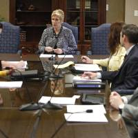 Photo - State schools Superintendent Janet Barresi speaks to new board members during the first school board meeting for the Oklahoma Virtual Charter School, at the State Education Department in Oklahoma City, OK, Monday, March 18, 2013,  By Paul Hellstern, The Oklahoman