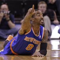 Photo - New York Knicks' J.R. Smith (8) points up court after the ball goes out of bounds in the first quarter during an NBA basketball game against the Utah Jazz Monday, March 31, 2014, in Salt Lake City. (AP Photo/Rick Bowmer)