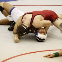 Photo - Tuttle's Seth Shelton (red) and Vinita's Alex Kauffman (white) wrestle in the 160 pound match at the 4A West Regional wrestling championship in Harrah on Saturday, Feb. 22, 2014. Tuttle's Seth Shelton defeated Vinita's Alex Kauffman with a pin to advance to state. Photo by KT King, The Oklahoman