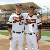 Photo - Brothers Randy, left, and Brendan McCurry are playing baseball together for Oklahoma State University at Allie P. Reynolds Stadium in Stillwater, OK, Tuesday, May 7, 2013,  By Paul Hellstern, The Oklahoman