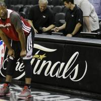 Photo - Miami Heat's Dwyane Wade pauses during NBA basketball practice, Saturday, June 15, 2013, in San Antonio. The Heat take on the San Antonio Spurs in Game 5 of the NBA Finals on Sunday, with the best-of-seven games series even at 2-2.  (AP Photo/David J. Phillip)
