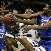 Photo - Kentucky's Samarie Walker (23) and Brittany Henderson (40) pressure South Carolina's Elem Ibiam (33) during the first half of their NCAA college basketball game, Thursday, Jan. 24, 2013, in Columbia, S.C. (AP Photo/Mary Ann Chastain)