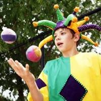 Photo - Left: Jack Wagner juggles during a medieval fair on Tuesday at the St. Elizabeth Ann Seton Catholic School in Edmond.