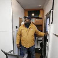 Photo - Edmond police officer Curtis Thompson presses buttons that expand the walls of the department's new command trailer. Photo by Paul Hellstern, The Oklahoman  PAUL HELLSTERN - Oklahoman