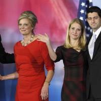 Photo -   Republican presidential candidate and former Massachusetts Gov. Mitt Romney and his wife Ann Romney, left, and vice presidential candidate, Rep. Paul Ryan, R-Wis., and his wife Janna, right, wave to supporters after Romney conceded the race during his election night rally, Wednesday, Nov. 7, 2012, in Boston. (AP Photo/Stephan Savoia)