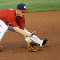Photo - Oklahoma City's Brian Bixler (2) fields a ground ball during a minor league baseball game between the Oklahoma City RedHawks and the Round Rock Express at Chickasaw Bricktown Ballpark in Oklahoma City, Thursday, April 26, 2012. Photo by Nate Billings, The Oklahoman