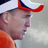 Photo - The breath of Denver Broncos quarterback Peyton Manning exhales as he talks to the media after NFL football practice at the team's training facility in Englewood, Colo., on Thursday, Jan. 23, 2014. The Broncos are scheduled to play the Seattle Seahawks in Super Bowl XLVIII on Feb. 2. (AP Photo/Ed Andrieski)