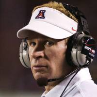 Photo - Arizona's head football coach Mike Stoops watches the game from the sidelines during the first half of an NCAA college football game against Northern Arizona at Arizona Stadium in Tucson, Ariz., Saturday, Sept. 12, 2008. (AP Photo/John Miller) ORG XMIT: AZJM101