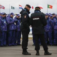Photo - Russian security personnel wait for deployment in the Olympic Park as security measures continue to be implemented for the 2014 Winter Olympics, Thursday, Jan. 30, 2014, in Sochi, Russia. (AP Photo/Pavel Golovkin)
