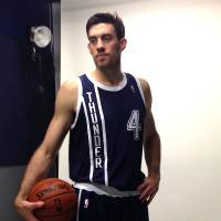 Photo - Nick Collison poses in the Thunder's new alternate jersey, which will make its debut in Friday night's home game against Detroit. The jersey can be ordered on-line starting Thursday at 4 p.m. Photo provided by Oklahoma City Thunder.