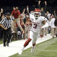 Photo -  Oklahoma's Sterling Shepard (3) runs up field for a touchdown during the NCAA football BCS Sugar Bowl game between the University of Oklahoma Sooners (OU) and the University of Alabama Crimson Tide (UA) at the Superdome in New Orleans, La., Thursday, Jan. 2, 2014. Photo by Sarah Phipps, The Oklahoman