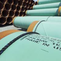 Photo -  Some of about 500 miles worth of coated steel pipe manufactured by Welspun Pipes Inc., originally for the Keystone oil pipeline, is stored in Little Rock, Ark.  AP File Photo   Danny Johnston -  AP
