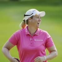 Photo - Brittany Lincicome, of Florida, reacts to her birdie shot on the 8th hole during the Wegmans LPGA golf championship in Pittsford, N.Y., Sunday, Aug. 17, 2014. (AP Photo/Gary Wiepert)