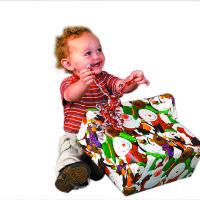 Photo - CHRISTMAS PRESENTS / GIFT / KIDS / CHILD / CHILDREN: Gabe McDonnell, 2, opens a present in OPUBCO studio Friday, Nov. 14, 2008. PHOTO BY DOUG HOKE THE OKLAHOMAN. ORG XMIT: KOD