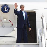 Photo - This Aug. 1, 2014, file photo shows Secretary of State John Kerry as he boards a plane to depart New Delhi, India, Secretary of State John Kerry will be focusing on Southeast Asia and the Pacific next week. He'll be leaving Friday on a six-day trip to Myanmar, Australia, the Solomon Islands and Hawaii. (AP Photo/Lucas Jackson, Pool)