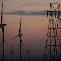 Photo -   This Nov. 3, 2012 photo shows wind turbines, alongside an electrical tower, at the National Wind Technology Center, run by the U.S. Department of Energy, outside Boulder, Colo. The wind energy boom touted by President Barack Obama as a key to America's energy strategy has hit a wall in an election-year political dispute with Republican lawmakers over taxpayer support for renewable energy. (AP Photo/Brennan Linsley)