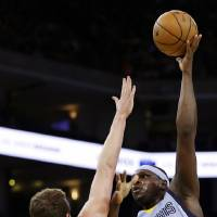 Photo - Memphis Grizzlies' Zach Randolph (50) shoots over Golden State Warriors' David Lee during the first half of an NBA basketball game, Wednesday, Jan. 9, 2013, in Oakland, Calif. (AP Photo/Ben Margot)