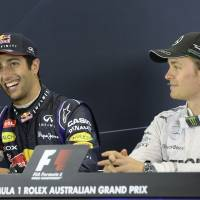 Photo - Red Bull driver Daniel Ricciardo of Australia,  left, and Mercedes driver Nico Rosberg of Germany, right, listen the questions during a press conference after the Australian Formula One Grand Prix at Albert Park in Melbourne, Australia, Sunday, March 16, 2014. Rosberg won the race and Ricciardo finished second. (AP Photo/Mal Fairclough)