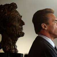 Photo -   FILE - In this Feb 11, 2009 file photo, former Gov. Arnold Schwarzenegger and a bust of Abraham Lincoln are seen in profile during a celebration of Lincoln's 200 birthday held at the California Museum of History, Women and the Arts in Sacramento, Calif. Schwarzenegger, who came to office during California's historic 2003 recall election, will soon be releasing his autobiography,