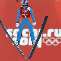 Photo - Sarah Hendrickson of the United States soars through the air during a women's ski jumping training session at the 2014 Winter Olympics, Saturday, Feb. 8, 2014, in Krasnaya Polyana, Russia. (AP Photo/Matthias Schrader)