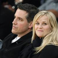 Photo - FILE - In this Friday, March 8, 2013 file photo, actress Reese Witherspoon and her husband, Jim Toth, watch the Toronto Raptors take on the Los Angeles Lakers in an NBA basketball game in Los Angeles. Police in Georgia say that Witherspoon has been arrested on a disorderly conduct charge after a traffic stop involving her husband in Atlanta. A Georgia State Police incident report says that Witherspoon was arrested early Friday, April 19, 2013, and charged with disorderly conduct. The report says a state trooper observed that a car driven by Toth was failing to stay in its lane. The officer writes that Witherspoon disobeyed multiple orders to stay in the car while he performed a field sobriety test on Toth. After she refused to return to the car, she was handcuffed and arrested. (AP Photo/Reed Saxon, File)