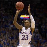 Photo -   Kansas guard Ben McLemore (23) shoots a three-point basket during the first half of an NCAA college basketball game against Chattanooga in Lawrence, Kan., Thursday, Nov. 15, 2012. (AP Photo/Orlin Wagner)