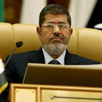 Photo - Egyptian President Mohammed Morsi attends the third session of the Arab Economic Summit, in Riyadh, Saudi Arabia, Monday, Jan. 21, 2013. Saudi Arabia is hosting the Arab Economic Summit on January 21 and 22. (AP Photo)