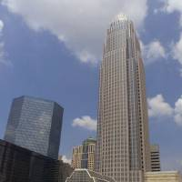 Photo - ** FILE ** Bank of America's corporate center, right, is shown in downtown Charlotte, N.C., Friday, July 28, 2000. Bank of America and FleetBoston Financial Corp. won approval from the Federal Reserve on Monday, March 8, 2004,  for a merger creating the third-largest U.S. bank, a behemoth holding nearly $1 trillion in assets and stretching from California through the South and up to New England.  (AP Photo/Chuck Burton)