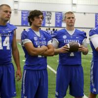 Photo - Kentucky starting quarterback hopefuls, from left, Patrick Towles, Reese Phillips, Drew Barker and Max Smith wait to have their photo taken during the team's NCAA college football media day, Friday, Aug. 8, 2014, in Lexington, Ky. (AP Photo/James Crisp)