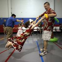 Photo - Above: Bryan Rich swings his daughter Christy, 6, Saturday during the Daddy-Daughter Dance in Moore. photos by SARAH PHIPPS, THE OKLAHOMAN