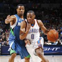 Photo - Oklahoma City's Russell Westbrook drives the ball past Sebastian Telfair of Minnesota during the NBA basketball game between the Oklahoma City Thunder and the Minnesota Timberwolves at the Ford Center in Oklahoma City, Friday, Nov. 28, 2008. BY NATE BILLINGS, THE OKLAHOMAN ORG XMIT: KOD