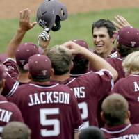 Photo - COLLEGE BASEBALL / BIG 12 BASEBALL TOURNAMENT / TEXAS A&M UNIVERSITY OF TEXAS / CELEBRATION: Texas A&M's Matt Juengel celebrates after hitting a home run in the fifth inning of a Big 12 baseball championship tournament game between Texas and Texas A&M at the AT&T Bricktown Ballpark in Oklahoma City, Saturday, May 29, 2010.  Photo by Bryan Terry, The Oklahoman  ORG XMIT: KOD