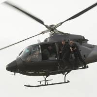 Photo -  Sullivan Stapleton (l) and Philip Winchester (r) take a helicopter ride. - Photo by Liam Daniel/Cinemax