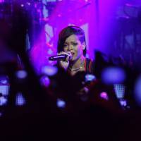 Photo -   Barbadian singer Rihanna performs during the first stop of her 777 worldwide tour at the Plaza Condesa in Mexico City, Wednesday, Nov. 14, 2012. (AP Photo/Marco Ugarte)