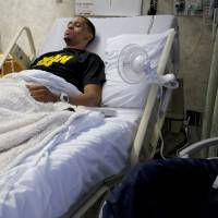 Photo - Bricktown shooting victim Norman Richards, 22, awaits discharge from Jim Thorpe Rehabilitation Hospital on Friday, June 22, 2012, a month and a day after the attack.  Photo by Chris Landsberger, The Oklahoman  CHRIS LANDSBERGER - CHRIS LANDSBERGER