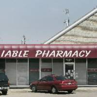 Photo - 2009 file photo - Reliable Pharmacy on 59th and Penn in Oklahoma City - Photo by Jaconna Aguirre